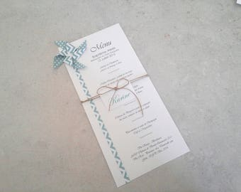 Menu and mark up mint green chevron dot patterned origami windmill for christening table decoration.