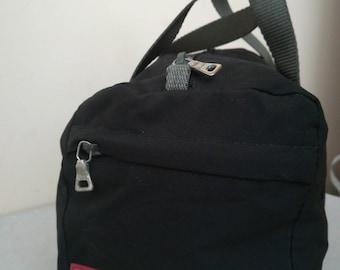 Prada Sport small bag in canvas bag.