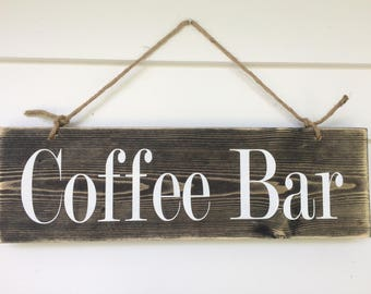 Coffee Bar sign, with distressing. Gray tones and distressed with painted white lettering.