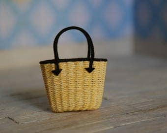 A miniature shopping basket