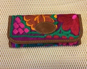 An embroidered wallet...
