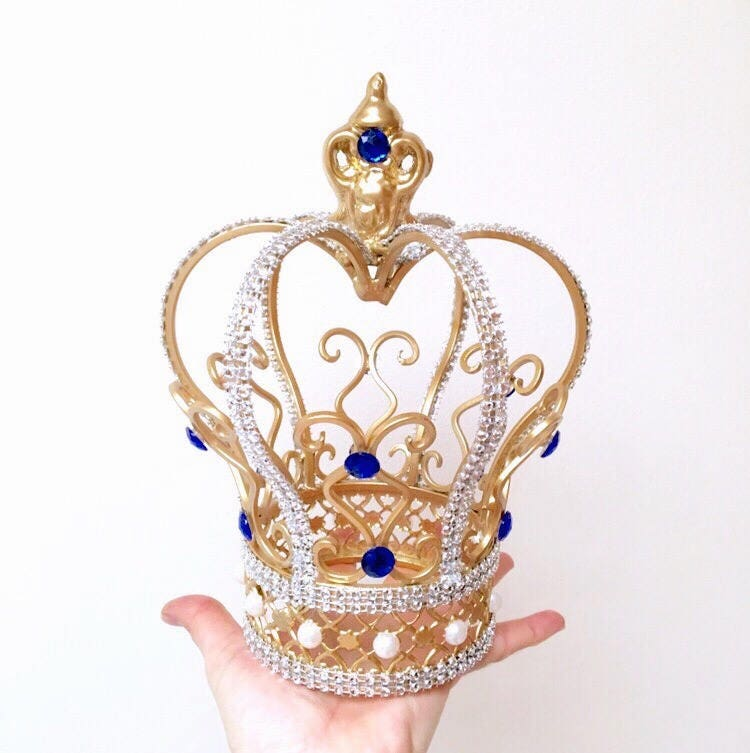 gold wedding cake topper australia gorgeous gold crown cake topper with royal blue crystals 14834