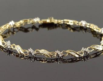 "10k 0.75 CTW Diamond Infinity Link Tennis Bracelet Gold 7.25"""