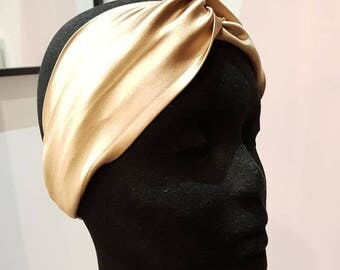 Fashionable gold satin headband