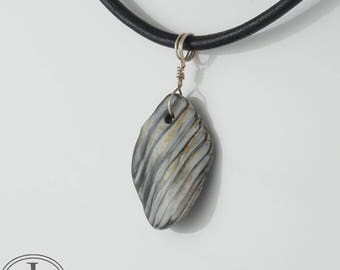 Fossilized Shell Pendant on Leather Necklace