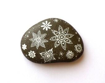 Pebble painted geometric flowers