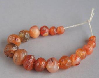 Ancient Roman carnelian beads, Natural carnelian beads,  II - lll century AD, 17 beads