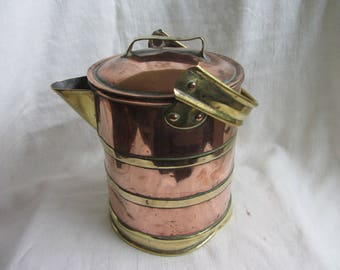 Battered antique copper and brass lidded jug, distressed metal pitcher. Rustic milk jug. Vintage Steampunk interior decor