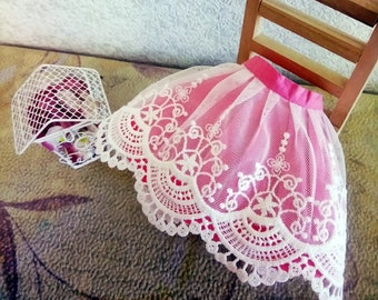The pink lace skirt