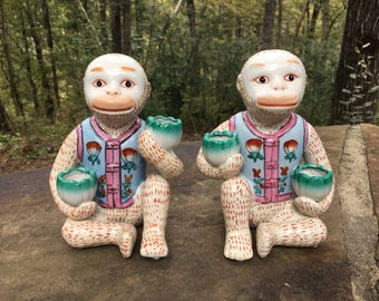 Pair Monkey Candlestick Holders.
