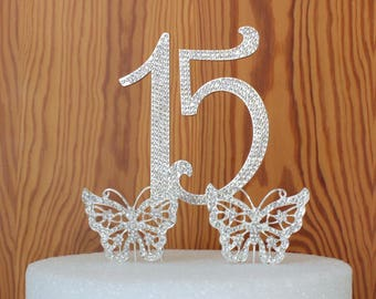 Quinceanera 15 birthday cake topper made with silver crystal rhinestones plus 2 rhinestone butterfly's center piece party decoration
