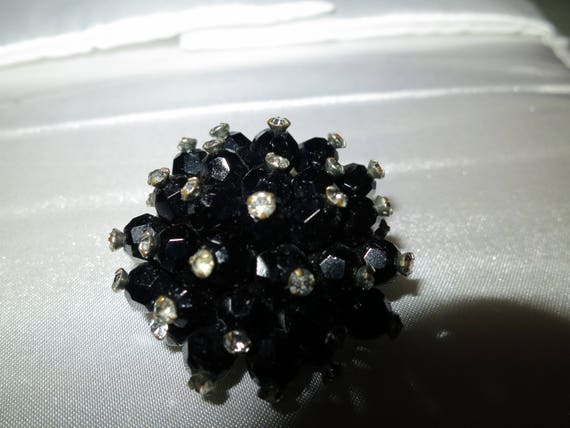 Lovely vintage black glass and rhinestone cluster brooch