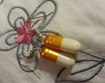 Earrings medication capsules