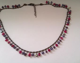copper coloured necklace with glass beads