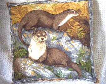 Two Otters on the rocks cushion