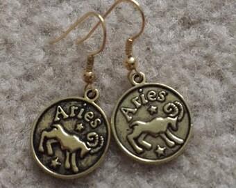 "Gold charm earrings, ""Aries"""