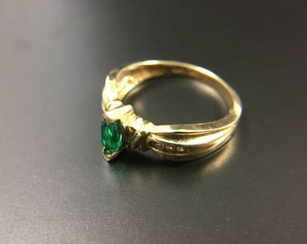 10K yellow gold ring with green and white stones