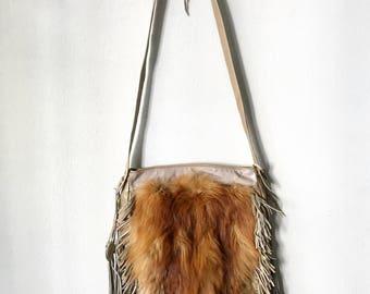 Red fox fur crossbody bags .