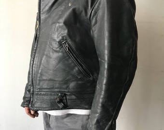 Very heavy and  strong motorcycle leather jacket man size large .