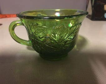 Green carnival glass cup