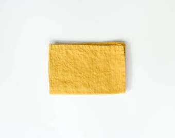two linen cloth napkins / mustard yellow / set of two