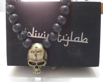 Lava stone necklace with brass skull