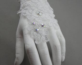 Pair of white for the bride lace glove. White lace