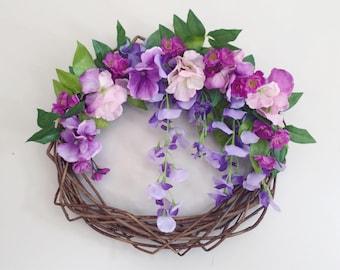 Purple wisteria wreath, hydrangeas,  blossoms, willow wreath base. Spring wreath -
