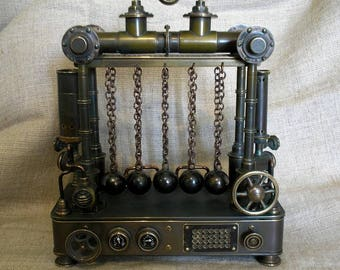 "Stand for writing instruments pencil case in the style of steampunk  ""Newton's Cradle"""