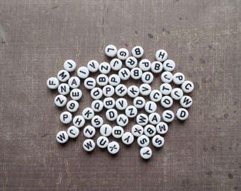 200 beads Alphabet white black color round shape