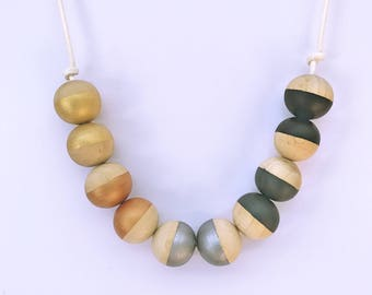 black, grey and metallic shades hand painted half a wooden bead necklace