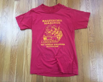 Vintage 80's Baltimore Marines tshirt size M(S) red TH combat engineer battalion tank dozer gun cartoon dog t plus tplus made in usa war