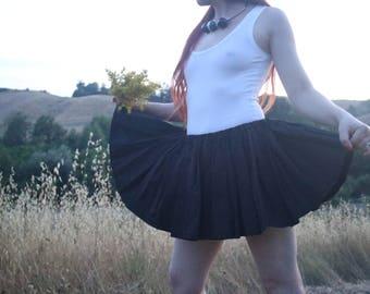 really short black skirt