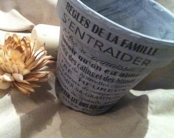 "Ceramic flower pot fired ""family rules"""
