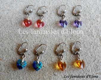 Earrings Silver earrings with swarovski crystal hearts.