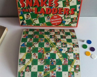Vintage snakes and ladders game, 1970's Spear's games, board, counters, dice.