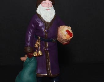 "Hallmark VINTAGE Christmas Ornament ""Merry Olde Santa"" - 6th In Merry Olde Santa Series - Santa In Purple Suit Carrying Bags Of Toys & Fruit"