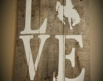 Love bucking horse wall sign