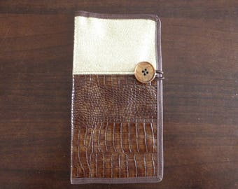 Gate cards, checkbook and documents, leatherette and matching lining.
