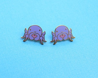 2 caring octopus pins