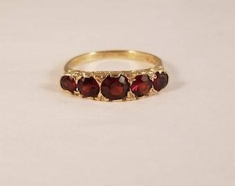 Vintage garnet 5 stone ring in yellow gold