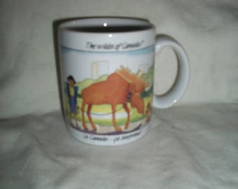 Vintage Funny Canada Coffee Mug, The Wilds of Canada!, with Art Work by John Cadiz, Woman Walking Moose