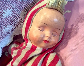 Vintage plastic faced, stuffed baby doll in striped outfit