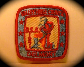 "Vintage 1970s Patch reads ""Valley Forge Council BSA Delmont 1971"" depicts Revolutionary War soldier crouched with sword"