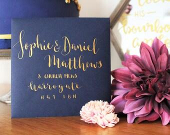 Hand lettered calligraphy envelope addressing - gold ink