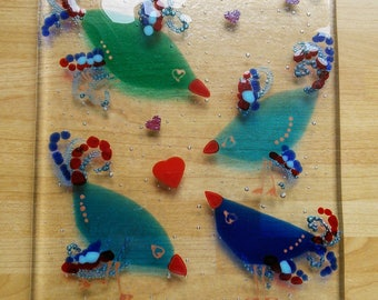 Fused glass pot stand, bubbles and birds, blues and transparent reds kiln formed, glass blue birds vase/pot/teapot stand.