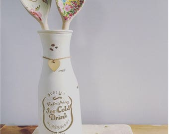 Hand painted vase with any two spoons.
