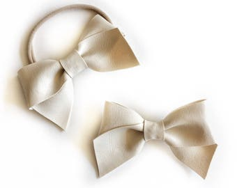 Large White Faux Leather Hair Bow -  Attached to a nylon headband or clip