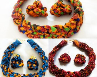 sets of colourful and bright red, orange and blue and orange african prints braided necklaces and earrings