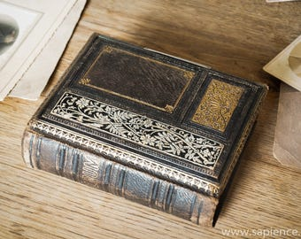 Lovely well made French antique photo album of tooled leather richly decorated with gold and silver